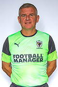 AFC Wimbledon coach Vaughan Ryan during the official team photocall for AFC Wimbledon at the Cherry Red Records Stadium, Kingston, England on 8 August 2019.