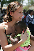 01-20-2005--Ashley Judd, Global Ambassador for YouthAIDS attends a village meeting outside of Nairobi, Kenya on January 20, 2005.  The meeting was facilitated by Population Services International and YouthAIDS and focused on improving health for mothers and their children.  Ashley Judd was named Global Ambassador for YouthAIDS in 2003 and has traveled to Asia, Africa and Latin America to boost the organization's HIV prevention efforts among 15-24 year olds. <br /> <br /> Photo by Jenny Mayfield for YouthAIDS