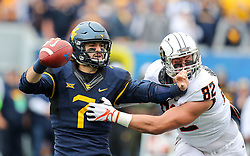 Oct 28, 2017; Morgantown, WV, USA; West Virginia Mountaineers quarterback Will Grier (7) is sacked by Oklahoma State Cowboys defensive end Cole Walterscheid (82) during the first quarter at Milan Puskar Stadium. Mandatory Credit: Ben Queen-USA TODAY Sports