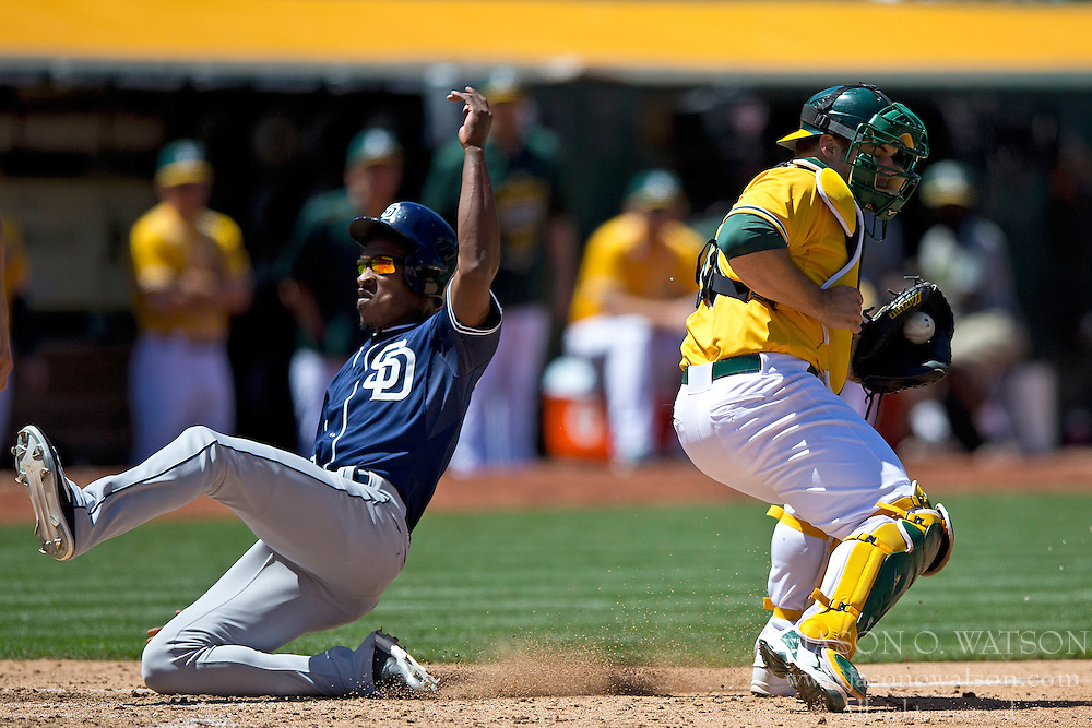 OAKLAND, CA - JUNE 18:  Melvin Upton Jr. #2 of the San Diego Padres scores a run past Josh Phegley #19 of the Oakland Athletics during the eighth inning at O.co Coliseum on June 18, 2015 in Oakland, California. The San Diego Padres defeated the Oakland Athletics 3-1. (Photo by Jason O. Watson/Getty Images) *** Local Caption *** Melvin Upton Jr.; Josh Phegley