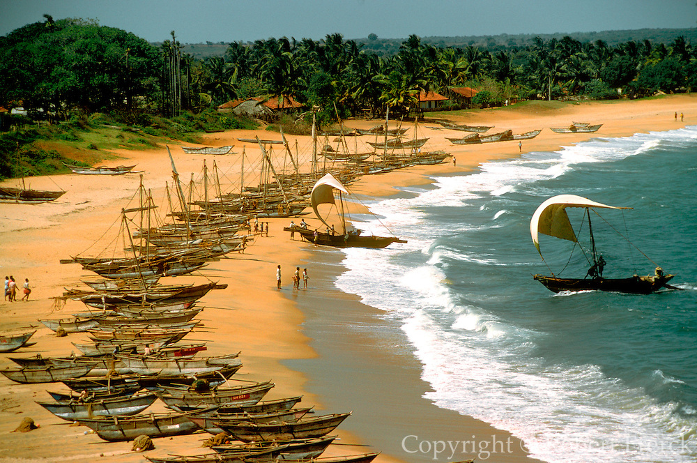 SRI LANKA, SEA COASTS fishing boats on shore at a village near Galle on the island's southern coast