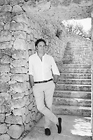 "FASANO, ITALY - 22 JULY 2018: Aldo Melpignano (40), proprietor of Borgo Egnazia, a high-end resort in Puglia, poses for a portrait here at Borgo Egnazia in Fasano, Italy, on July 22nd 2018.<br /> <br /> Borgo Egnazia, modeled after a 15th century Apulian village, rolls out over 250 acres on a plot of land originally razed by Mussolini and intended as an air force base, ending nearing the Adriatic. Aldo Melpignano, the 40 years old owner, has pioneered a hospitality company that has managed to seize on the hype surrounding wellness and authentic experiences at once. His company, SD Hotels, turns Puglia's traditional farmhouses into resorts that focus on fitness (Apulian folk dance classes in 400 year old olive groves) and otherworldly spa treatments (one massage uses ""vibrational water"") in addition to traditional Italian fare (milk serum, handmade orecchiette pasta, octopus in a broth of just-plucked tomatoes). <br /> <br /> Borgo Egnazia is the largest of his five properties, with three public pools, a village square out of central casting, and nearly 200 rooms.  Celebrities like Madonna have been won over by Borgo Egnazia's faux Medieval facades and farmhouse chic interiors, an effect best described as ""Game of Thrones"" meets Restoration Hardware. Justin Timberlake and Jessica Biel got married here in 2012. SD Hotels, which last year saw revenues of $57 million, started with his family's summer home, Masseria San Domenico, a few miles down the road from Borgo Egnazia."