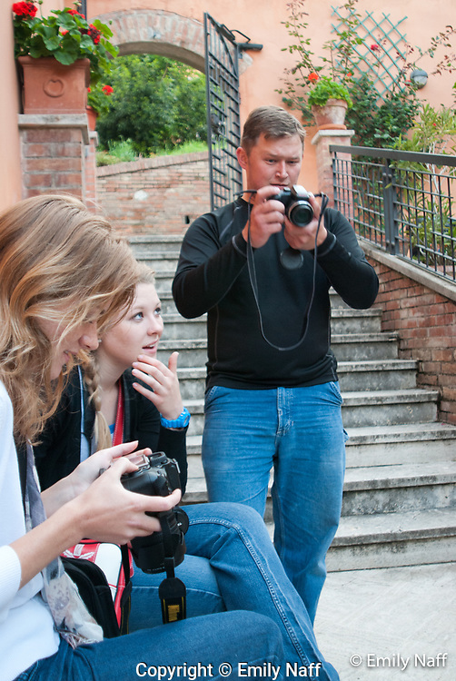 Photography students learning about all the features on their cameras.