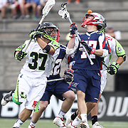 Kyle Sweeney #77 of the Boston Cannons and Jerry Ragonese #37 of the New York Lizards fight for a flying ball during the game at Harvard Stadium on July 19, 2014 in Boston, Massachusetts. (Photo by Elan Kawesch)