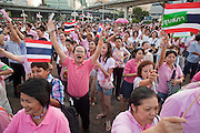 "Apr. 2, 2010 - BANGKOK, THAILAND: Pink Shirt protestors call for an end to Red Shirt protests during a demonstration for peace in Bangkok Friday. Thousands of ""Pink Shirts,"" who claim to be neither ""Red Shirts"" nor ""Yellow Shirts"" nicknames for Thailand's dueling political forces, gathered in Lumpini Park in central Bangkok Friday evening to call for ""peace in the land,"" a play on the Red Shirts slogan, ""Red in the Land."" The ""Pink Shirts"" represented educators, business people and people in the tourist industry, all of which have been hurt by the ongoing political protests that have disrupted life in the Thai capital. The ""Pink Shirts"" stressed their loyalty to His Majesty Bhumibol Adulyadej, the King of Thailand, and chanted for the Red Shirts to ""Get Out!"" of Bangkok.    PHOTO BY JACK KURTZ"