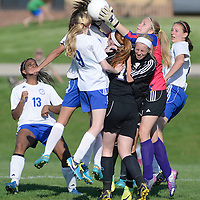 Laura Stoecker/lstoecker@dailyherald.com<br /> Burlington Central's Cali Andrew (9) collies with Hampshire's Jessica Boutin and Paige Palubicki as Hampshire goalie Arianna Rominski leaps to block a hit in the second half of the Class 2A regional semifinal on Tuesday, May 14.