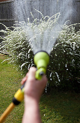 © Licensed to London News Pictures. 04/04/2012. Middlesex, U.K..Gardeners take advantage of the last day of hosing until Hosepipe bans are put into force by water companies in the south east of england from tomorrow the 5th april 2012 until further notice..Photo credit : Rich Bowen/LNP