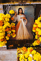 A picture of Jesus with garlands of flowers inside Se Cathedral in Goa, India.