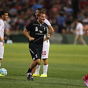 Liverpool manager Brendan Rogers jogs to the bench after half time during the Liverpool Vs AS Roma friendly pre season football match at Fenway Park, Boston. USA. 23rd July 2014. Photo Tim Clayton