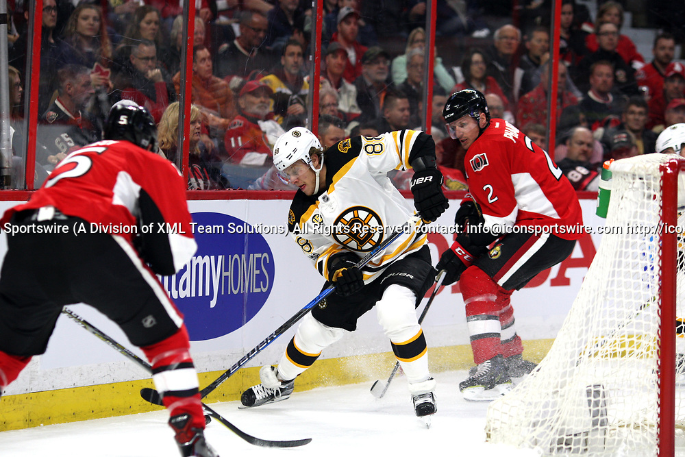 OTTAWA, ON - APRIL 12:  Boston Bruins Right Wing David Pastrnak (88) moves the puck past Ottawa Senators Defenceman Dion Phaneuf (2) and attempts to put it passed Ottawa Senators Defenceman Cody Ceci (5) during the first round of the NHL Playoffs  between the Boston Bruins and Ottawa Senators on April 12, 2017, at Canadian Tire Centre in Ottawa, On. (Photo by Jason Kopinski/Icon Sportswire)