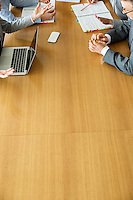 Cropped image of businesspeople discussing at conference table