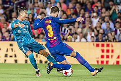 August 13, 2017 - Barcelona, Catalonia, Spain - Real Madrid forward RONALDO competes with FC Barcelona defender PIQUE for the ball during the Spanish Super Cup Final 1st leg between FC Barcelona and Real Madrid at the Camp Nou stadium in Barcelona (Credit Image: © Matthias Oesterle via ZUMA Wire)