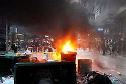 Hong Kong. 29 September, 2019. Illegal march by thousands of pro-democracy supporters from Causeway Bay to Government offices at Admiralty. Police unsuccessfully tried to stop march at start with teargas fired and scuffles. March marked the 5th anniversary of the start of the Umbrella Movement.Pic. Fires burn in Wanchai street.