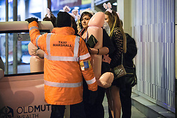 """© Licensed to London News Pictures . Manchester , UK . 05/04/2015 . Women queue to board a taxi opposite """" The Printworks """" in Manchester City Centre . Revellers on a Saturday night out during the Easter Bank Holiday weekend . Photo credit : Joel Goodman/LNP"""