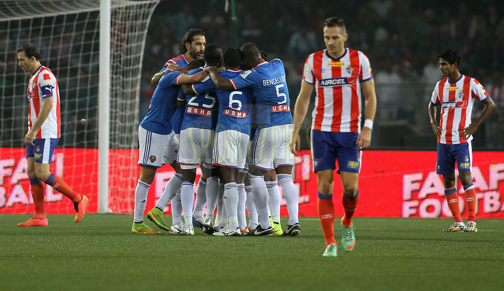 FC Goa players celebrates a goal scored by Edgar Carvalho Figueira Marcelino of FC Goa during match 55 of the Hero Indian Super League between Atletico de Kolkata and FC Goa held at the Salt Lake Stadium in Kolkata, West Bengal, India on the 10th December 2014.<br /> <br /> Photo by:  Vipin Pawar/ ISL/ SPORTZPICS