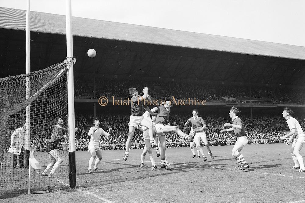 22/09/1968<br /> 09/22/1968<br /> 22 September 1968<br /> All Ireland Minor Football Final: Sligo v Cork at Croke Park Dublin. <br />B. Cummins (arm stretched out behind him) Cork full forward punches the ball accross the bar  as the Sligo defenders look on helplessly.