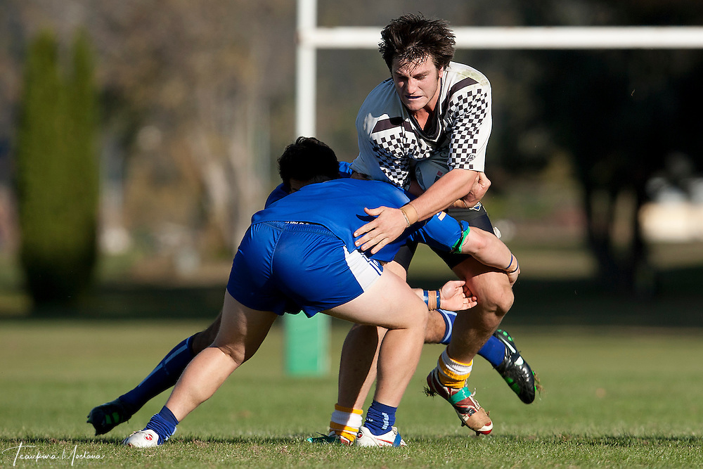 Brenton Howden of Winton is tackled during the round three Southland District Rugby league match between the Wakatipu Giants and Winton at Queenstown Events Centre, Queenstown, New Zealand, Sunday April 22, 2012. Credit:Teaukura Moetaua / Media Sport