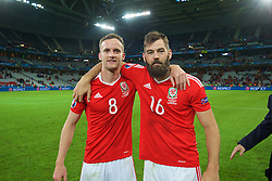 LILLE, FRANCE - Friday, July 1, 2016: Wales' Andy King and Joe Ledley celebrates after a 3-1 victory over Belgium and reaching the Semi-Final during the UEFA Euro 2016 Championship Quarter-Final match at the Stade Pierre Mauroy. (Pic by David Rawcliffe/Propaganda)