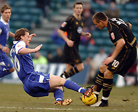 Picture: Henry Browne.<br /> Date: 26/02/2005.<br /> Gillingham v Wigan Athletic Coca Cola Championship.<br /> Michael Flynn of Gills flies in on Lee McCulloch of Wigan.