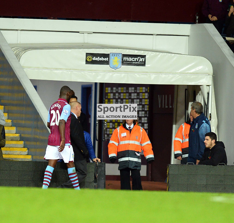 Christian Benteke of Aston Villa heads up the tunnel after being sent off