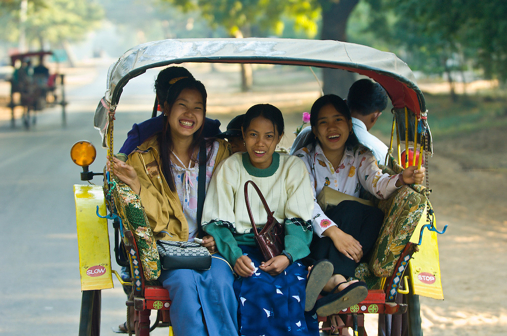 Burmese women riding in a horse cart, Bagan, Myanmar (Burma)