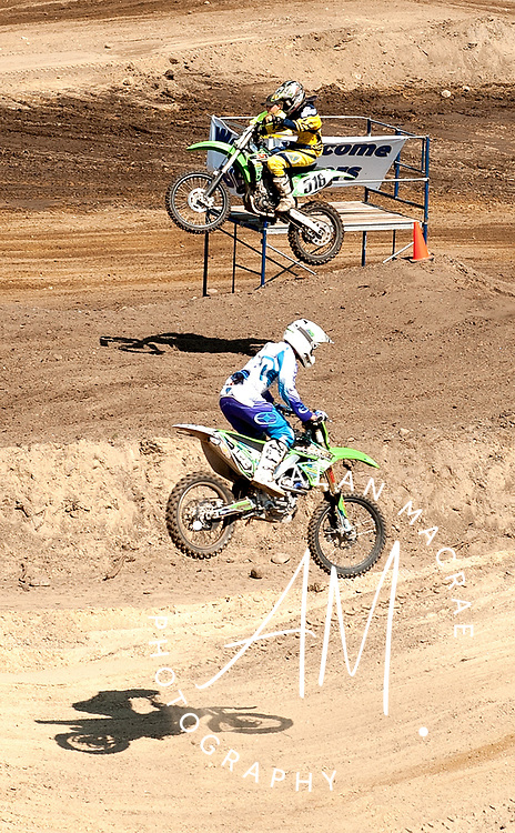 A pair of comptetitors sail through the air during Friday's first Moto Cross event at the Lodge At Belmont.  (Alan MacRae/for the Citizen)