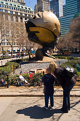 New York City, New York: Sculpture The Sphere by Fritz Koenig, saved from Ground Zero and relocated to Battery Park, symbol of world peace, public grieving site for 9-11 attack.  .Photo #: ny231-14798  .Photo copyright Lee Foster, www.fostertravel.com, lee@fostertravel.com, 510-549-2202.