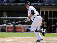 CHICAGO - JUNE 12:  Paul Konerko #14 of the Chicago White Sox hits an RBI single in the seventh inning against the Oakland Athletics on June 12, 2011 at U.S. Cellular Field in Chicago, Illinois.  The White Sox defeated the Athletics 5-4.  (Photo by Ron Vesely)   Subject:  Paul Konerko