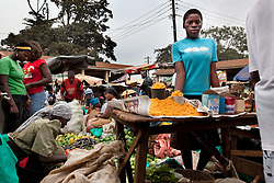Phiona Mutesi, a 14-year-old chess prodigy, inside Katwe, the largest slum in Kampala, Uganda, Dec. 8, 2010. Her days are spent in search of food, working at the market with her mother and dreaming of an escape from Katwe's slums. Mutesi lives in the slums of Uganda and is just now learning to read. But her instincts have made her a player to watch in international chess. Mutesi, a naturally talented chess player is coached by Robert Katende of Sports Outreach Ministry. The chess club meets at the Agape Church.