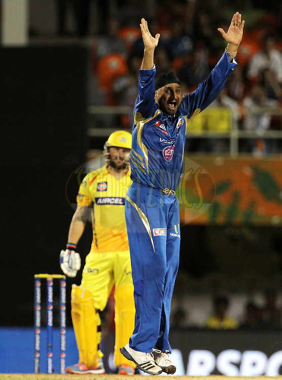 Harbhajan Singh of the Mumbai Indians appeals unsuccessfully during the eliminator match of the Pepsi Indian Premier League Season 2014 between the Chennai Superkings and the Mumbai Indians held at the Brabourne Stadium, Mumbai, India on the 28th May  2014<br /> <br /> Photo by Vipin Pawar / IPL / SPORTZPICS<br /> <br /> <br /> <br /> Image use subject to terms and conditions which can be found here:  http://sportzpics.photoshelter.com/gallery/Pepsi-IPL-Image-terms-and-conditions/G00004VW1IVJ.gB0/C0000TScjhBM6ikg