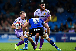 Max Bodilly of Exeter Chiefs is challenged by Elliott Stooke of Bath Rugby - Mandatory by-line: Ryan Hiscott/JMP - 21/09/2019 - RUGBY - Sandy Park - Exeter, England - Exeter Chiefs v Bath Rugby - Premiership Rugby Cup