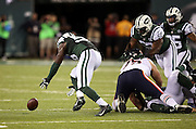 New York Jets inside linebacker Demario Davis (56) recovers the loose ball after Chicago Bears quarterback Jay Cutler (6) fumbles on a second quarter sack by New York Jets inside linebacker David Harris (52) during the NFL week 3 regular season football game against the New York Jets on Monday, Sept. 22, 2014 in East Rutherford, N.J. The Bears won the game 27-19. ©Paul Anthony Spinelli