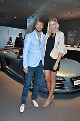 RICK PARFITT JNR and RACHEL GRETTON at the Global Launch of Audi's first Digital Showroom, 74-75 Piccadilly, London on 16th July 2012.