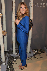 CARA DELEVINGNE at a Dinner to celebrate the launch of the Mulberry Cara Delevingne Collection held at Claridge's, Brook Street, London on 16th February 2014.