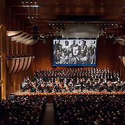 """November 11, 2012 - New York, NY : Accompanied by members of the Metropolitan Opera Orchestra and The New York Choral Society, and conducted by Patrick Summers (standing center right), soprano Liudmyla Monastyrska (standing center left) performs Giuseppe Verdi's """"Vieni, t'affretta"""" from Macbeth during the 2012 Richard Tucker Gala and concert in Lincoln Center's Avery Fisher Hall on Sunday evening. CREDIT: Karsten Moran for The New York Times"""