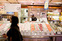 "2 October, 2008. New York, NY. The Wild Edibles fish stand at the Grand Central Market displays its fresh products with Country of Origin Labels (COOL). The signs and symbols on the labels also indicate the sustainability of the seafood. Wild Edibles came up with the idea 2 years ago and implemented it last year, though the COOL is not mandatory for them, since the total amount of their invoicing does not require it. ""We do it because this way people are more aware of where the food they purchase comes from"", says Steve Schafel, director of retail operations. ""We do it as a service for our customers"".<br /> <br /> ©2008 Gianni Cipriano for The New York Times<br /> cell. +1 646 465 2168 (USA)<br /> cell. +1 328 567 7923 (Italy)<br /> gianni@giannicipriano.com<br /> www.giannicipriano.com"