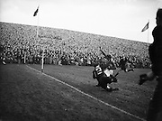 Irish Rugby Football Union, Ireland v New Zealand, Tour Match, Landsdowne Road, Dublin, Ireland, Saturday 9th January, 1954,.9.1.1954, 1.9.1954,..Referee- DR P F Cooper, Rugby Union,..Score- Ireland 3 - 14 New Zealand,..Irish Team,..J G M W Murphy, Wearing number 15 Irish jersey, Full Back, Lurgan Rugby Football Club, Armagh, Northern Ireland, ..M Mortell, Wearing number 14 Irish jersey, Right wing, Bective Rangers Rugby Football Club, Dublin, Ireland, and, Dolphin Rugby Football Club, Cork, Ireland, ..N J Henderson, Wearing number 13 Irish jersey, Right centre, N.I.F.C, Rugby Football Club, Belfast, Northern Ireland, ..A C Pedlow, Wearing number 12 Irish jersey, Left centre, Queens University Rugby Football Club, Belfast, Northern Ireland,..J T Gaston, Wearing number 11 Irish jersey, Left wing, Dublin University Rugby Football Club, Dublin, Ireland, .. J W Kyle, Wearing number 10 Irish jersey, Captain of the Irish team, Stand Off, N.I.F.C, Rugby Football Club, Belfast, Northern Ireland, ..J A O'Meara, Wearing number 9 Irish jersey, Scrum half, Dolphin Rugby Football Club, Cork, Ireland, ..J H Smith, Wearing number 1 Irish jersey, Forward,  London Irish Rugby Football Club, Surrey, England, ..F E Anderson, Wearing number 2 Irish jersey, Forward, Queens University Rugby Football Club, Belfast, Northern Ireland,..W A O'Neill, Wearing number 3 Irish jersey, Forward, Wanderers Rugby Football Club, Dublin, Ireland, ..R H Thompson, Wearing number 4 Irish jersey, Forward, Instonians Rugby Football Club, Belfast, Northern Ireland, ..P J Lawlor, Wearing number 5 Irish jersey, Forward, Clontarf Rugby Football Club, Dublin, Ireland,..J S McCarthy, Wearing number 6 Irish jersey, Forward, Dolphin Rugby Football Club, Cork, Ireland, ..T E Reid, Wearing number 7 Irish jersey, Forward, Garryowen Rugby Football Club, Limerick, Ireland, ..R Kavanagh, Wearing number 8 Irish jersey, Forward, Wanderers Rugby Football Club, Dublin, Ireland, ..New Zealand Team,..R W H Scott, Wearing numbe