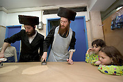 Israel, Tel Aviv, Preparing Matzah. In order for the matza to be Kosher strict baking procedures must be followed, All hand made and under a strict watch of the Rabbi April 2005, Young children watching the process
