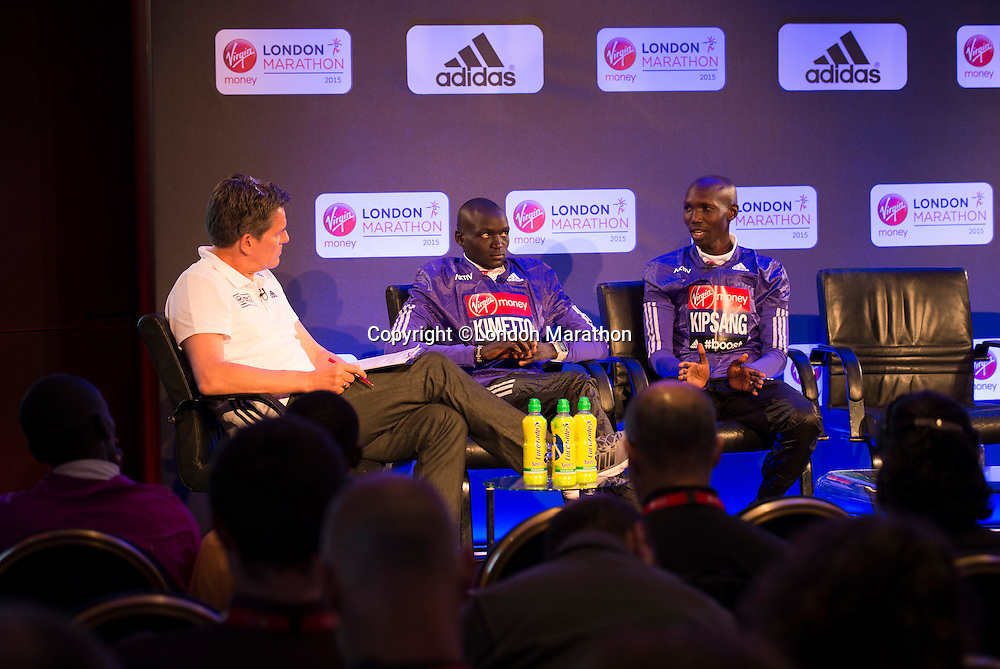 Virgin Money London Marathon 2015<br /> <br /> Press conference featuring some of the the leading contenders for the London Marathon  being interviewed by Tim Hutchings.<br /> <br /> Left to Right<br /> Dennis Kimetto  Kenya<br /> Wilson Kipsang  Kenya<br /> <br /> Photo: Bob Martin for Virgin Money London Marathon<br /> <br /> This photograph is supplied free to use by London Marathon/Virgin Money.