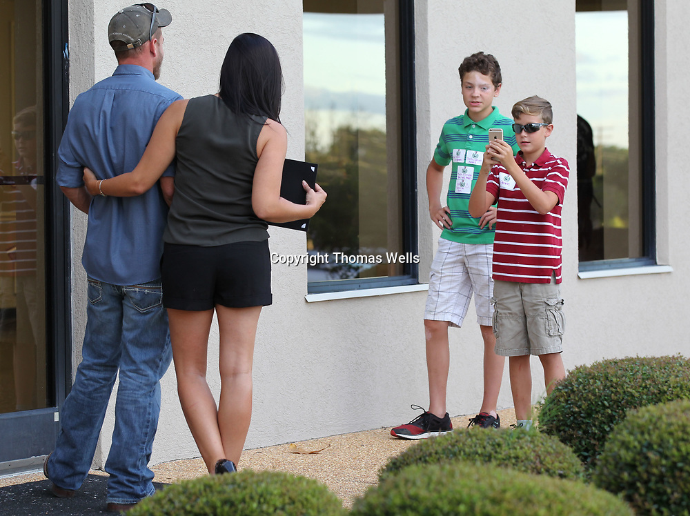 Matt Peay, from left, and Tiffany Fisher get Christian Simpson and his brother Carter to take a couple of photos of them after Peay's business The Thirsty Devil won two first place awards at Thursday's Reader's Choice Awards.