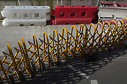 A length of construction industry accordion-style Turtle Gates, is stretched across the road infront of plastic barriers, at a site in Tottenham Court Road in central London, on 11th February 2020, in London, England.