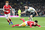 Derby County defender Scott Malone heads the ball away from Nottingham Forest midfielder Joe Lolley during the EFL Sky Bet Championship match between Derby County and Nottingham Forest at the Pride Park, Derby, England on 17 December 2018.