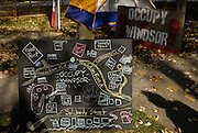 There is an artist who paints the signs, makes the 'rose and fist' logo stencil for the patch that is worn by many memebers and after someone brought up the idea, a site map of the camp. Occupy Windsor, Canada, November 2011.