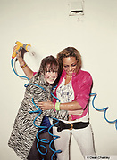 Leila and Adele, spraying each other with water, Southend, UK 2006
