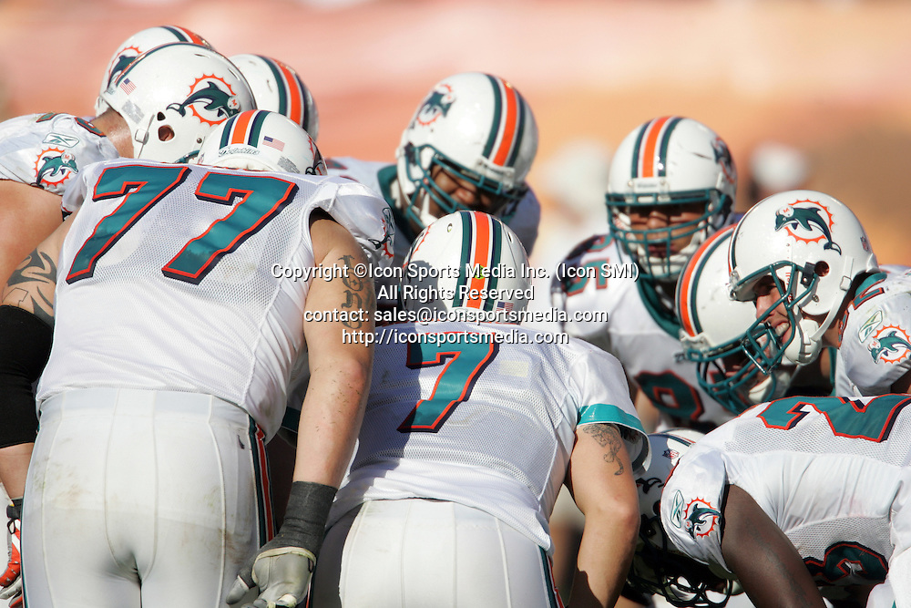 15 NOV 2009:  Jake Long (77) and his Dolphin teammates listen to Chad Henne (7) make the call in the huddle during the game between the Tampa Bay Buccaneers and the Miami Dolphins at Landshark Stadium in Miami Gardens, FL.  The Dolphins defeated the Buccaneers by the score of 25 to 23.