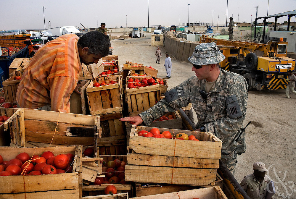 A U.S. Army  Border Transition Team (BTT) member searches an Iraqi tomato truck October 1, 2007 at the Zurbatiya border crossing on the Iraq-Iran border in Wasit province. The U.S. military has stepped up monitoring at the crossing, an alleged transit point for weapons flowing in from Iran in recent months.