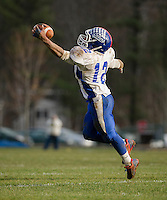 Interlakes Malik Carter makes a one handed catch during Saturday's NHIAA semi final football with Winnisquam.  (Karen Bobotas/for the Laconia Daily Sun)