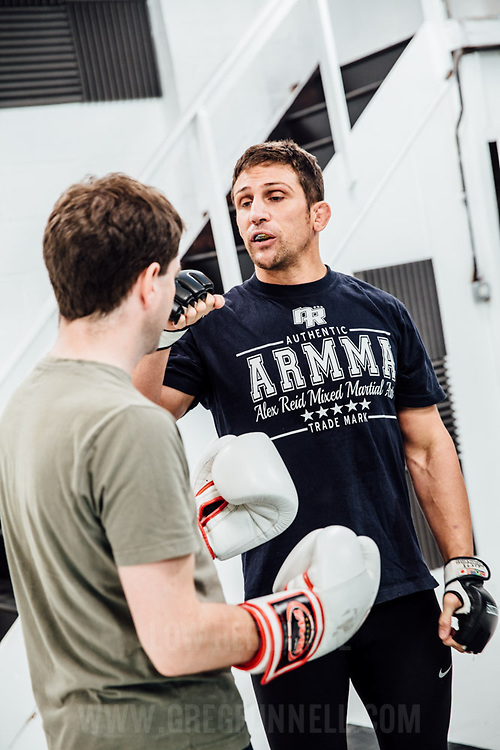 Financial Times Journalist Barney Thompson (green t-shirt) is trained in Mixed Martial Arts by fighter Alex Reid. UK, 27th October 2014. Photo by Greg Funnell.