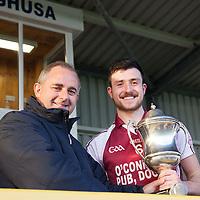 St. Brekan's Captain Stephen Nagle receiving the U21 B Football Final cup