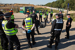 West Hyde, UK. 14th September, 2020. Hertfordshire Police officers prepare to remove environmental activists from HS2 Rebellion who had used lock-on arm tubes to block a gate to the South Portal site for the HS2 high-speed rail link. Anti-HS2 activists blocked two gates to the same works site for the controversial £106bn rail link, one remaining blocked for over six hours and another for over twelve hours.